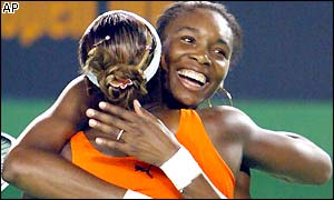 Serena and Venus WiIlliams show their delight at winning the doubles title