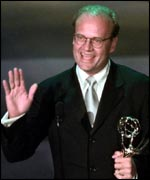 Kelsey Grammer receives his Emmy award in 1998