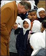 Prince Charles meets Muslim children during a visit to Leicester