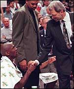 Phil Jackson shakes hands with Bulls legend Michael Jordan
