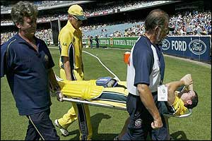 Australian batsman Michael Bevan is taken off after injurying himself