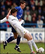 Harry Kewell of Leeds and Gillingham's Nicky Southall tangle at Priestfield