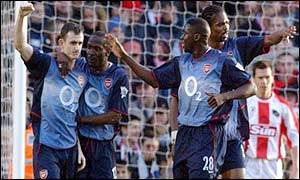 Francis Jeffers is congratulated by team-mates after scoring Arsenal's second after 23 minutes