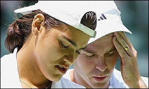 Eleni Daniilidou of Greece and Todd Woodbridge of Australia look shattered after defeat