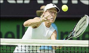 Martina Navratilova plays a volley over the net