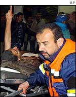 Emergency worker accompanies an injured man