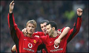 Ryan Giggs is congratulated by David Beckham and Roy Keane