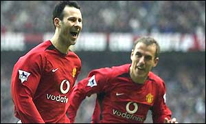 Ryan Giggs celebrates his first goal with Phil Neville