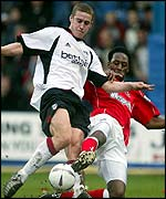 Fulham's Sean Davis is tackled by Jason Euell
