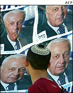 Jewish boy looks at election poster of Ariel Sharon