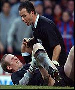 Liverpool goalkeeper Chris Kirkland is helped by referee Rob Stiles after suffering an injury at Crystal Palace