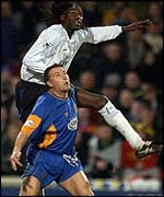 Shrewsbury's Nigel Jemson and Chelsea's Mario Melchiot challenge for the ball