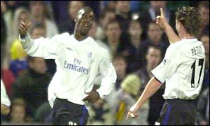 Carlton Cole celebrates his goal with Emmanuel Petit