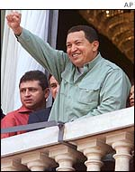 Venezuelan President Hugo Chavez waves to the crowd in Brazil