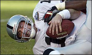 Oakland Raiders quarterback Rich Gannon is sacked by Tampa Bay Buccaneers