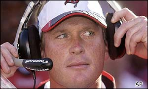 Tampa Bay Buccaneers head coach Jon Gruden adjusts his headphones