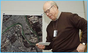 UN chief weapons inspector Dr Hans Blix with disk of his report