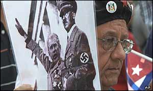 Demonstrator at the World Social Forum holds composite picture of Bush and Hitler