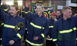 Striking firefighters, one sporting a Tony Blair mask, picket Watford Fire Station, Hertfordshire