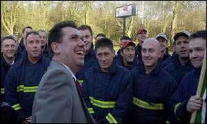 Fire Brigades Union general secretary Andy Gilchrist shares a joke with striking firefighters at Watford Fire Station, Hertfordshire