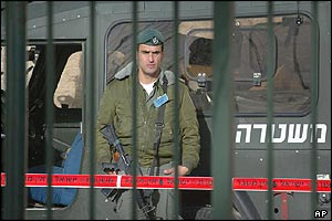 Israeli soldier guards road to polling station