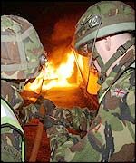 Soldier fight a fire