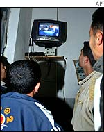 Palestinians in Gaza City watching Israeli election on television
