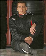 Justin Wilson sits in the pits