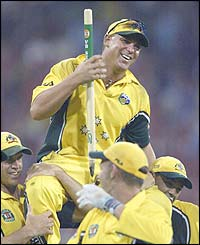 Shane Warne is carried off in jubilation after the Australkia's win the VB series on his home ground at the MCG