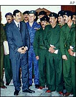 Saddam Hussein with military leaders in Iraq