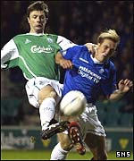 Paul Fenwick beats Rangers' Fernando Ricksen to the ball