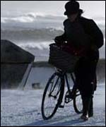 A cyclist struggles through the Whitley Bay blizzards