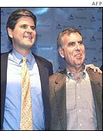 Steve Case and Gerald Levin at the announcement of the AOL Time Warner merger