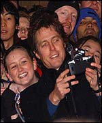 Hugh Grant with fans in Leicester Square