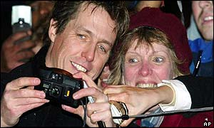 Hugh Grant with a fan