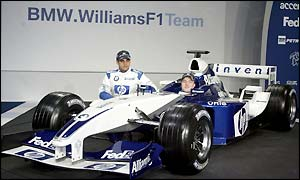 Montoya and Schumacher pose for photographs with the new car