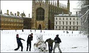 Cambridge University students have a snowball fight behind Kings College