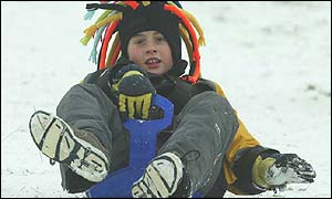 Angus Joyce, 10, uses a sledge in Wandlebury, Cambridge
