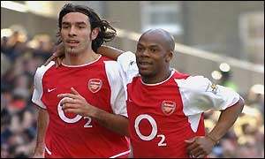 Pires and Wiltord celebrate