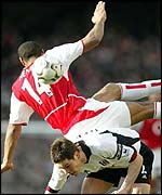 Arsenal's Thierry Henry challenges Fulham's Steve Finnan