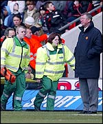 Sir Alex Ferguson looks on as Fabien Barthez is stretchered off