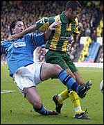 Adam Chambers holds off City new boy Robbie Fowler