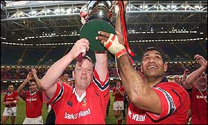 Mick Galwey and the Munster captain Jim Williams raise the trophy