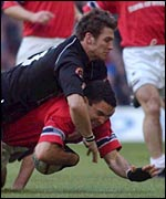 Neath's James Storey tackles Jeremy Staunton of Munster