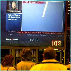 News spreads: People read the news about the explosion on big video screens at Frankfurt train stations