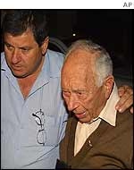 Eliezer Wolferman (right) is comforted