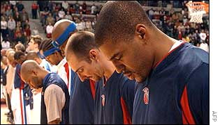Detroit Pistons basketball players pause in silence