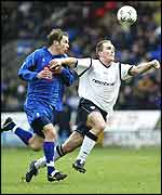 Henrik Pedersen of Bolton (right) takes on Kenny Cunningham