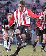 Kevin Phillips steps up to score a penalty