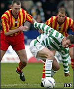 Chris Sutton holds off Thistle's Kevin McGowne